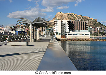 Alicante - Pier with steel palm trees and Saint Barbara's...