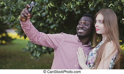 interracial couple take selfie