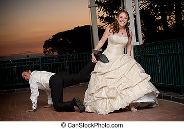 sexy red head bride dragging her young handsome groom by the...