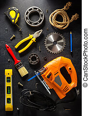 jig saw and tools on black - jig saw and tools on black...