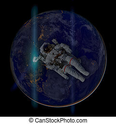 Astronaut in outer space. Earth on the background.