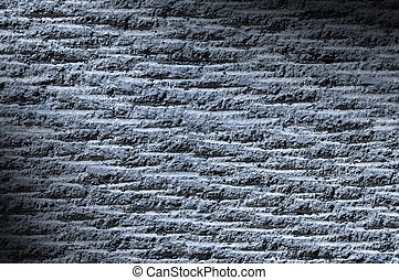 Grooved asphalt or rock surface texture lit diagonally with blue light