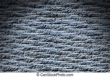 Grooved asphalt or rock surface texture lit from above with...