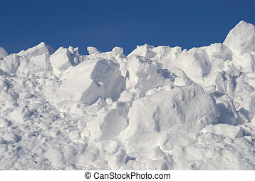 Snow Pile - Pile of snow against blue sky