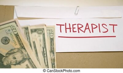 Therapist cost concept - Cash payment for therapist