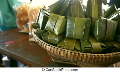 Traditional thai dessert wrapped in banana leaves