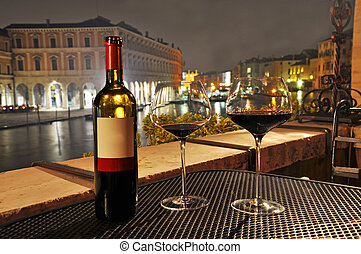 Wine in Venice - Glasses and bottle of a red wine in Venice.