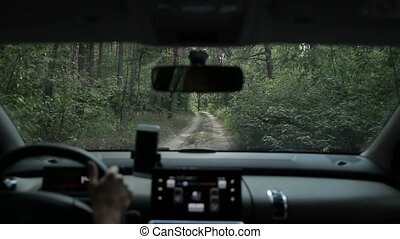 Vehicle driving off-road on trail road in forest - Woman...