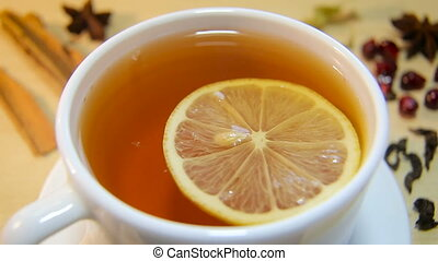 A cup of hot black tea with lemon