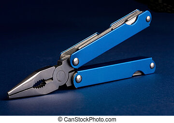 Multitool - blue background mutli purpose tool