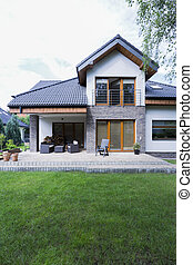 House with brick walls and patio - Modern and spacious house...