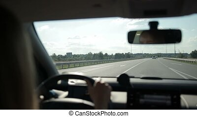 View on curvy road from car's interior - Tourist woman...