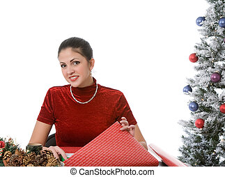 Wrapping Holiday Presents - Woman wrapping christmas...
