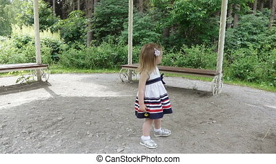 Girl dancing on nature - In city park girl baby in dress...