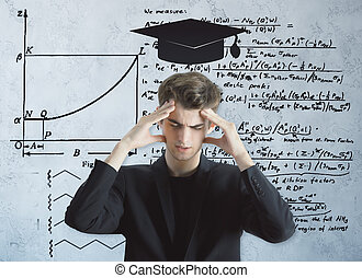 Knowledge concept - Pensive young man with drawn mortarboard...