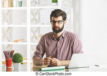 Talking businessman in office