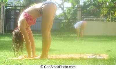 Beautiful young slim women doing yoga on the grass in the shine morning. 3840x2160, 4k