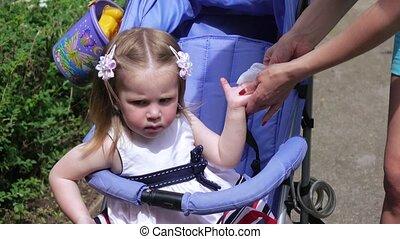 Girl baby wipe his hands
