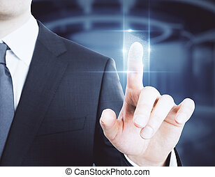 Biometrics concept - Businessman pressing abstract digital...