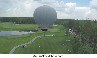 Big air balloon in white color with basket. Aerial on the big balloon