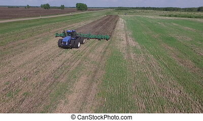 copter flight over the field and a tractor stock footage,