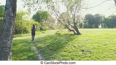 Woman running in park - Morning cardio for weight loss....