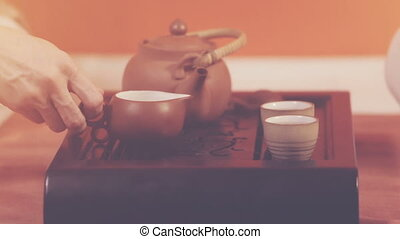 Tea ceremony. Orange toning - Tea ceremony. A man and woman...