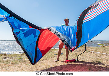 Kite Surfer - Kiteboarder preparations for surfing on a...