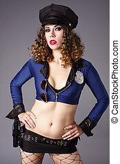 Sexy police woman with gun