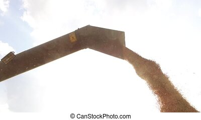 Combine harvester architecture unloading grain into a wagon....
