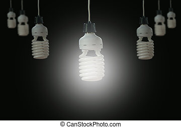 Hanging light bulbs with glowing one on dark background. Idea and creativity concept with light bulbs.