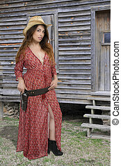 Cowgirl with relvolver - Beautiful young country girl woman...