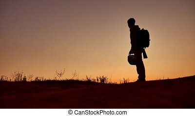 The boy is a teenager traveling at dawn. Travel tourist...