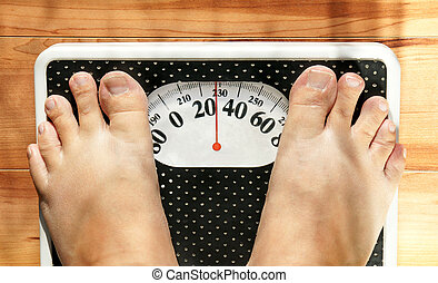 Obese feet on scale - Feet of a fat person on a weight scale...