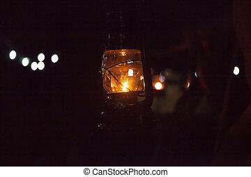 Burning kerosene lamp in dark, concept lighting