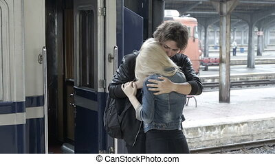Sad young man in love caressing and saying goodbye to his...