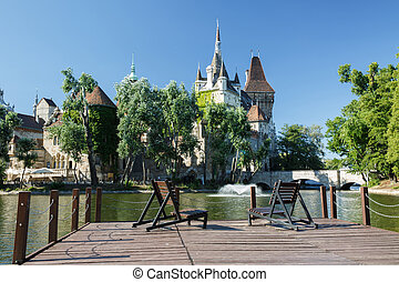 place to relax on the lake in the park area with a view of...