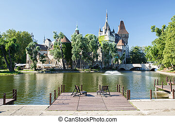 view of the Historical Vajdahunyad Castle with lake in City...