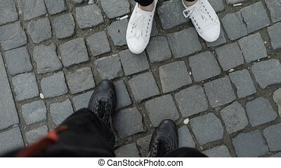 Point of view POV of boy and girl feet meeting and exchange...