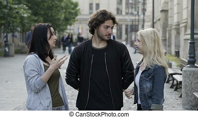 Teenagers friends talking outdoor in public urban street...