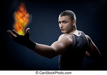 young boxer with fire - portrait of a young boxer with fire...
