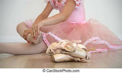 Ballerina Kneading His Legs - Llittle Ballerina Sitting On...