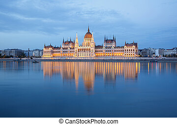 Budapest Parliament building at evening on the Danube river...