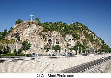 Cave church, cross and statue of Liberty on the Gellert Hill...