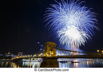 Fireworks in Budapest. View of the illuminated Chain Bridge...