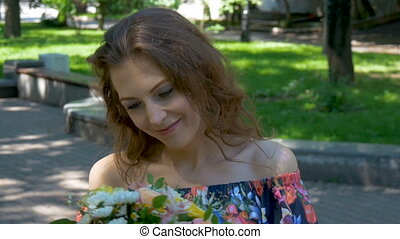 Portrait of a beautiful girl with a bouquet of flowers Young...