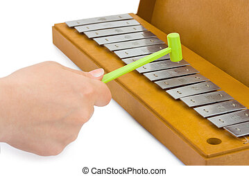 Hand and xylophone isolated on white background