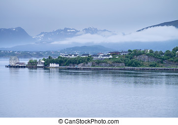 Hessa is an island in Alesund Municipality in More og...