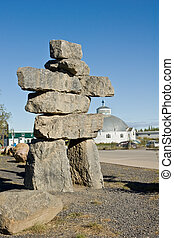 Inuvik Inukshuk - An Inukshuk and the igloo church in...