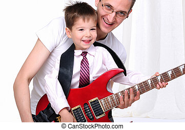 young father teaches his young son - A young father teaches...